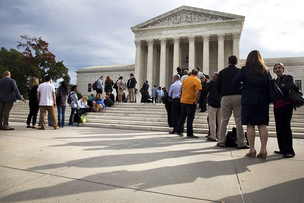 People line up outside of the Supreme Court in Washington, Tuesday, Oct. 13, 2015, as Justices began to discuss sentences for young prison 'lifers.' A decision in Montgomery v. Louisiana, 14-280, is expected by late spring. (AP Photo/Jacquelyn Martin)