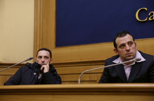 Daniele, left, and Giuseppe Lo Porto, brothers of Giovanni Lo Porto, an Italian al-Qaida hostage killed in a U.S. drone strike, listen during a press conference in Rome Tuesday, March 15, 2016. The family of Giovanni Lo Porto is appealing to U.S. President Barack Obama to provide details about the January 2015 operation that led to his death.  Lo Porto was killed along with fellow aid worker and hostage Warren Weinstein and two al-Qaida operatives. (AP Photo/Gregorio Borgia)