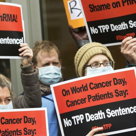 Cancer patients and survivors protested drug policy changes the TPP could bring in February outside the headquarters of the drug industry's lobbying operation in Washington, D.C.