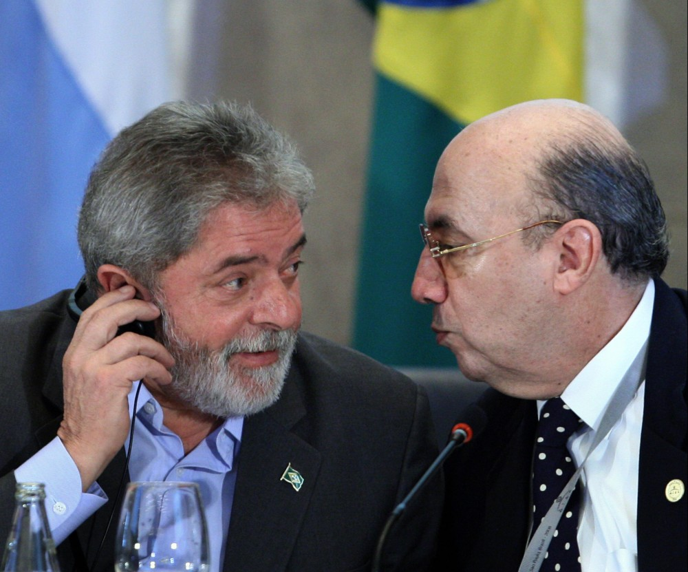Brazil's President Luiz Inacio Lula da Silva (L) chats with Central Bank president Henrique Meirelles, during the opening of the G20 Ministers and Central Bank Governors' Meeting, in Sao Paulo, Brazil, on November 8, 2008. Looking to take the first steps toward revamping a global financial system ravaged by crisis, leaders from the main industrialized and emerging economies gather Saturday seeking common ground. European leaders have said they hope the Sao Paulo meeting will lay the groundwork for the start of key reforms to be put in motion starting with a November 15 summit in Washington of G20 leaders.  AFP PHOTO/Mauricio LIMA (Photo credit should read MAURICIO LIMA/AFP/Getty Images)