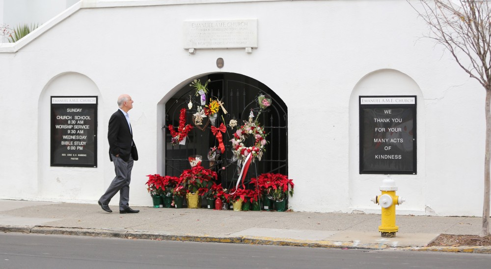 A man stops to observe the makeshift memorial in front of Mother Emanuel AME Church in downtown Charleston, South Carolina on January 4, 2017. Dylann Roof, the self-described white supremacist who gunned down nine black churchgoers in a Charleston church, offered no apology or motive for his actions as a jury began considering whether to sentence him to death. / AFP / Logan Cyrus (Photo credit should read LOGAN CYRUS/AFP/Getty Images)
