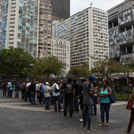 """Unemployed people queue to registrate to search for jobs in downtown Rio de Janeiro, Brazil on May 25, 2016.<br /><br /><br /><br /><br /><br /><br /><br /><br /><br /><br /><br /><br /><br /><br /><br /><br /><br /><br /><br /> According to the last survey, the unemployment rate has raised to 10.78%, the highest in the last years Brazil, as a strong economic crisis and corruption scandals hit the country. / AFP / VANDERLEI ALMEIDA        (Photo credit should read VANDERLEI ALMEIDA/AFP/Getty Images)"""" /></a></p> <p class="""