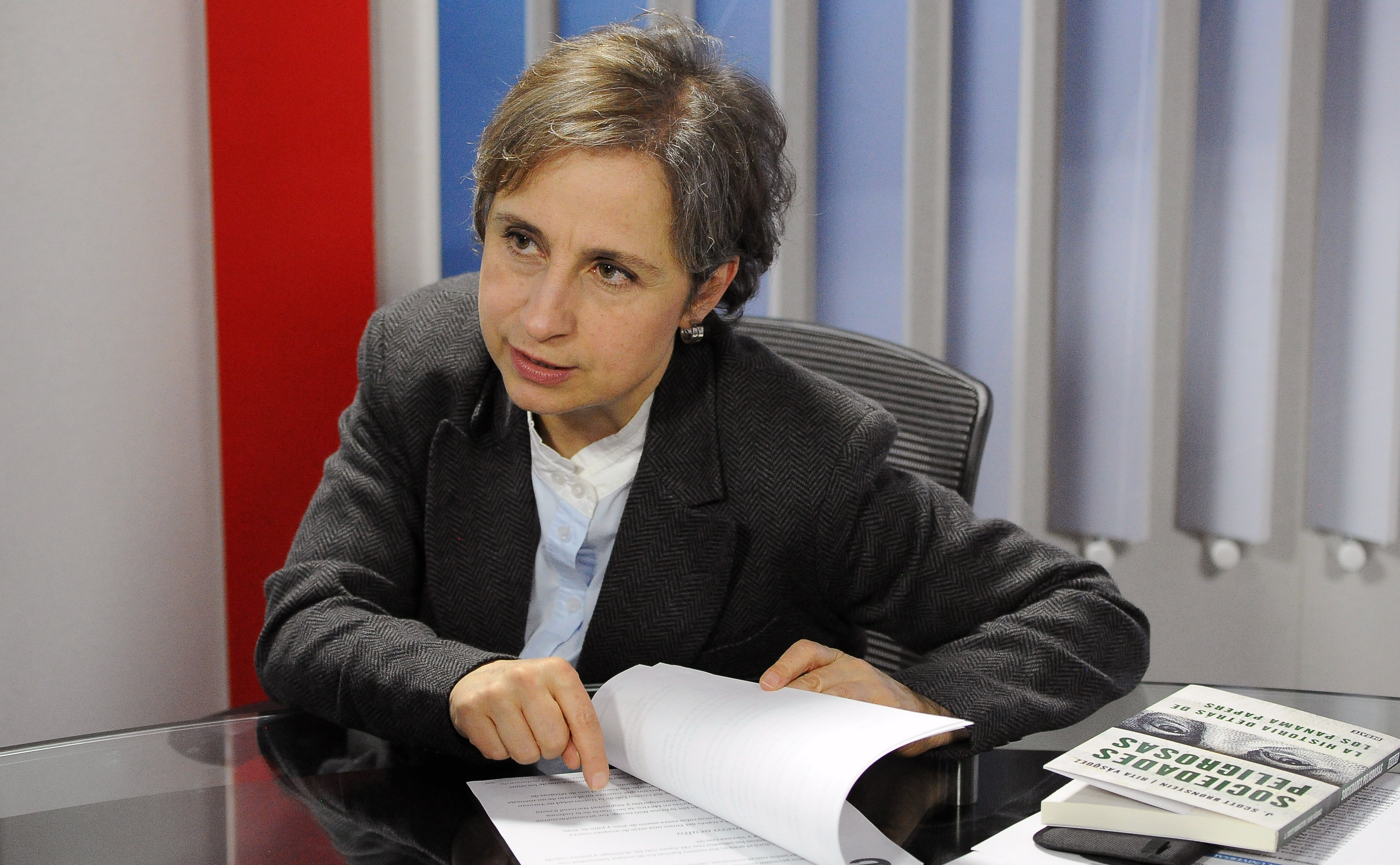 """Mexican journalist Carmen Aristegui speaks during an interview with AFP about the New York Times article """"Using Texts as Lures, Government Spyware Targets Mexican Journalists and Their Families"""", in Mexico City on June 22, 2017.Mexican prosecutors said Wednesday they have opened an investigation into allegations the government spied on leading journalists, human rights activists and anti-corruption campaigners. / AFP PHOTO / BERNARDO MONTOYA (Photo credit should read BERNARDO MONTOYA/AFP/Getty Images)"""