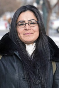 FILE - In this Dec. 8, 2017, file photo, Red Fawn Fallis, of Denver, stands outside the federal courthouse in Bismarck, N.D. A federal judge is refusing to delay the upcoming trial of Fallis, who is accused of shooting at law officers during protests in North Dakota against the Dakota Access pipeline. She's pleaded not guilty to federal civil disorder and weapons charges. Her trial begins Jan. 29, 2018., in Fargo, N.D. (Tom Stromme/The Bismarck Tribune via AP, File)