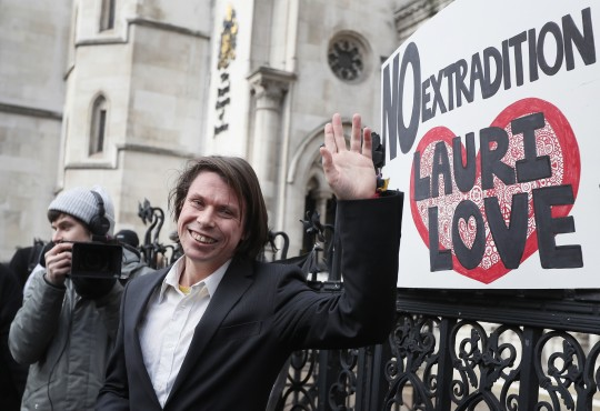 Lauri Love waves outside The Royal Courts of Justice in London, Monday, Feb. 5, 2018. The ruling in Lauri Love's appeal against extradition to the United States, where he faced solitary confinement and a potential 99 year prison sentence, was ruled in his favour on Monday Feb. 5 at the Royal Courts of Justice.(AP Photo/Kirsty Wigglesworth)