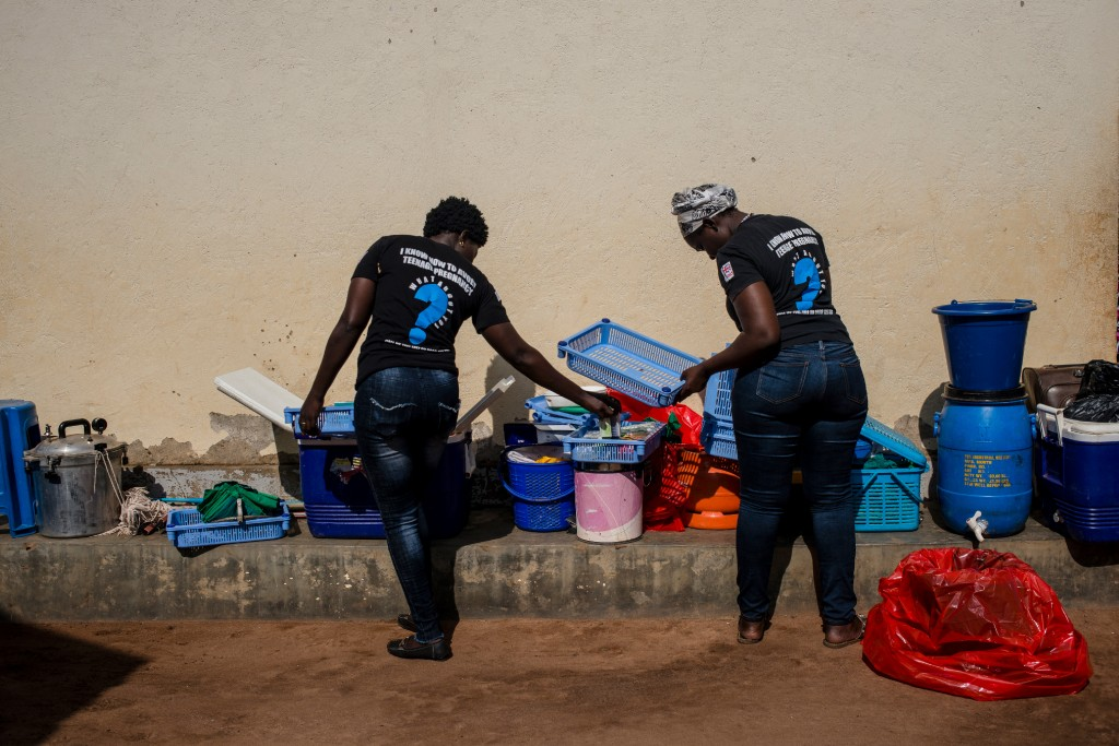 Marie Stopes health workers unload family planning supplies on March 26, 2018 in Parabongo, Uganda.