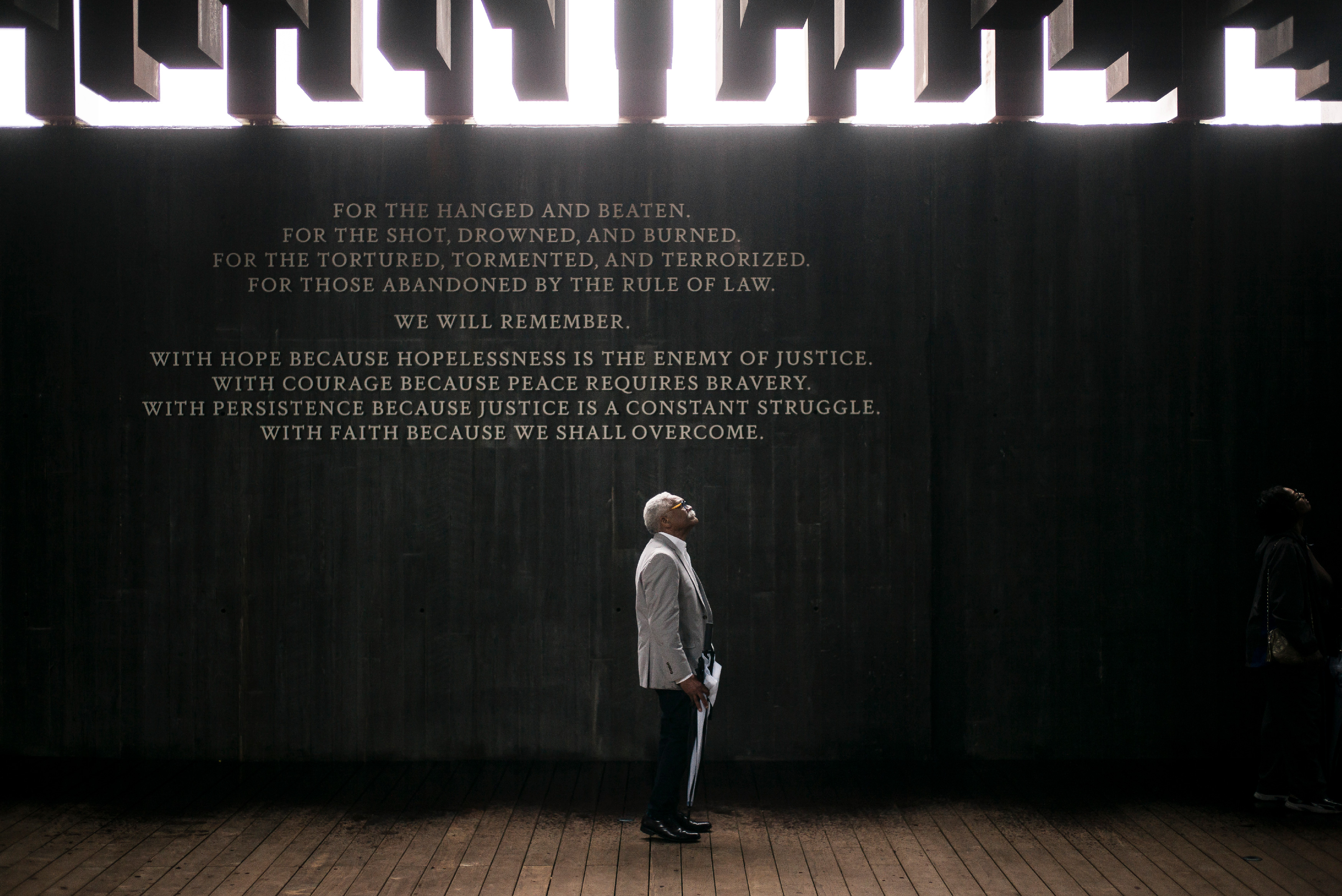 """MONTGOMERY, AL - APRIL 26: Ed Sykes, 77, visits the National Memorial For Peace And Justice on April 26, 2018 in Montgomery, Alabama. Sykes, who has family in Mississippi, was distraught when he discovered his last name in the memorial, three months after finding it on separate memorial in Clay County, Mississippi. """"This is the second time I've seen the name Sykes as a hanging victim. What can I say?"""" Sykes, who now lives in San Francisco, plans to investigate the lynching of a possible relative at the Equal Justice Initiative headquarters in Montgomery before returning to California. The memorial is dedicated to the legacy of enslaved black people and those terrorized by lynching and Jim Crow segregation in America. Conceived by the Equal Justice Initiative, the physical environment is intended to foster reflection on America's history of racial inequality. (Photo by Bob Miller/Getty Images)"""