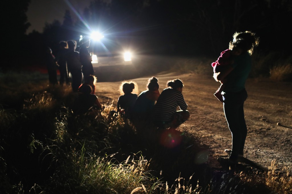 """U.S. Border Patrol agents arrive to detain a group of Central American asylum seekers near the U.S.-Mexico border on June 12, 2018 in McAllen, Texas. The group of women and children had rafted across the Rio Grande from Mexico and were detained before being sent to a processing center for possible separation. Customs and Border Protection (CBP) is executing the Trump administration's """"zero tolerance"""" policy towards undocumented immigrants. U.S. Attorney General Jeff Sessions also said that domestic and gang violence in immigrants' country of origin would no longer qualify them for political asylum status.  (Photo by John Moore/Getty Images)"""