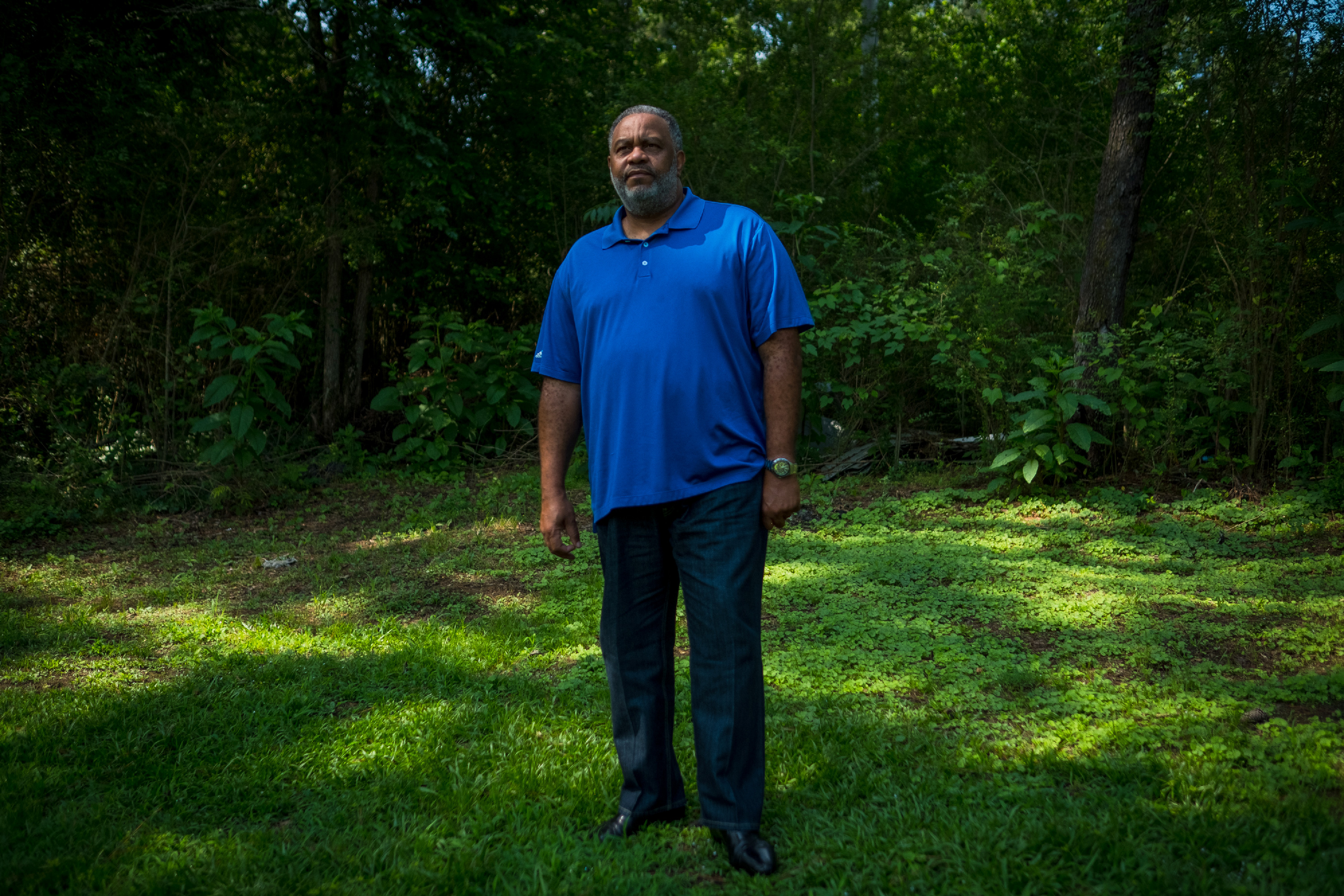 """Anthony Ray Hinton stands near the spot in the yard of his home in Quinton, Alabama, Sunday, June 3, 2018, where Alabama police officers came to arrest him for crimes he didn't commit in 1985. When he is not traveling, Hinton says he spends a lot of time outdoors. """"It just gives me a sense of belonging. When one has been locked up, the last place I want to be is stuck in the house. I love the outdoors."""" Hinton spent 30 years on death row after he was wrongfully incarcerated for two murders he did not commit. His recently released his memoir, """"The Sun Does Shine: How I Found Life and Freedom on Death Row.""""<br /> (Tamika Moore for The Intercept)"""