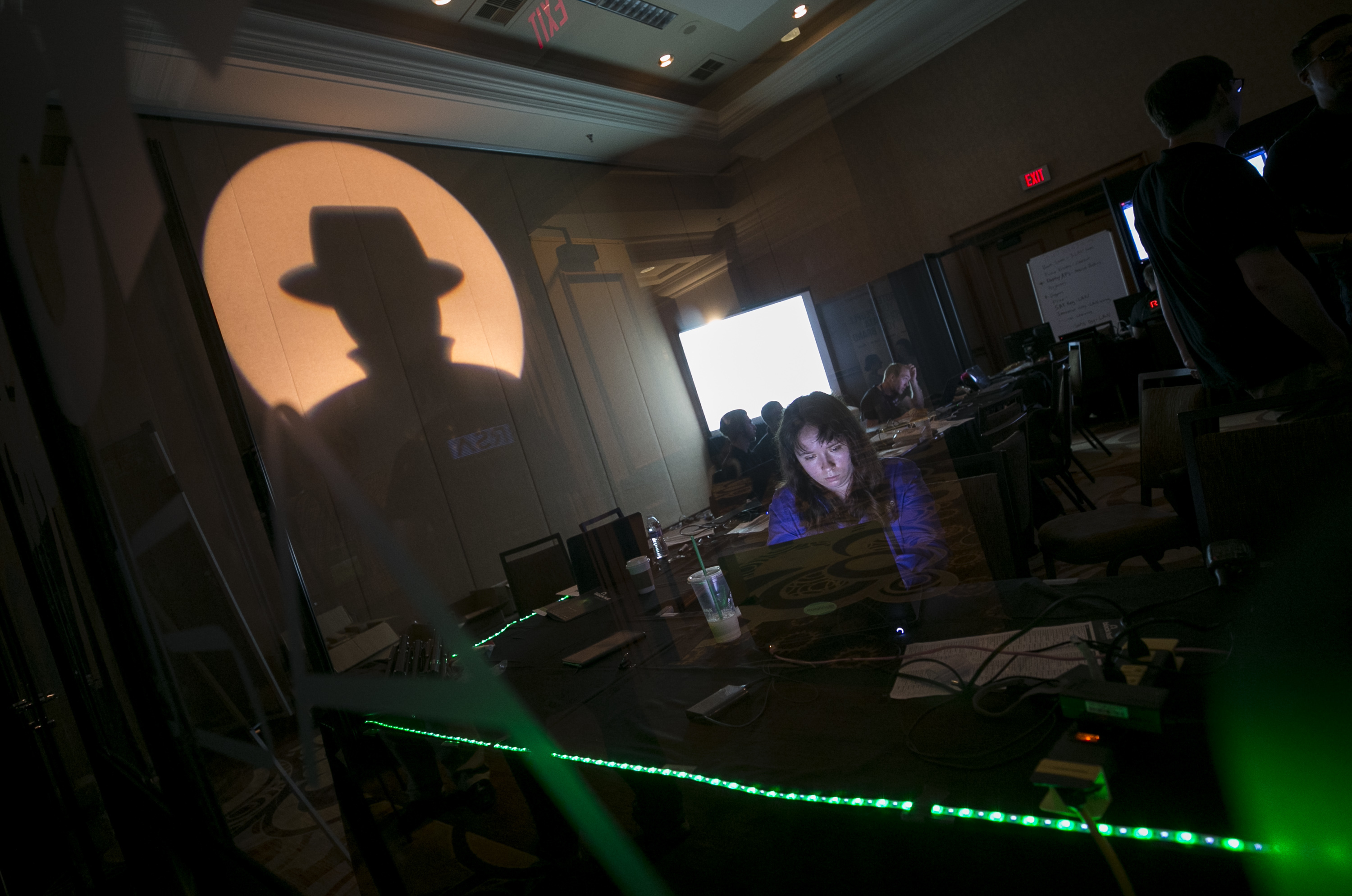 A Black Hat tech associate works in the network operating center (NOC) during the Black Hat information security conference at Mandalay Bay, Wednesday, July 26, 2017, In Las Vegas. Against a backdrop of cyberattacks that have grown into full-fledged sabotage, Facebook chief security officer Alex Stamos brought a sobering message Wednesday to hackers and security experts at the Black Hat conference. (Richard Brian/Las Vegas Review-Journal via AP)