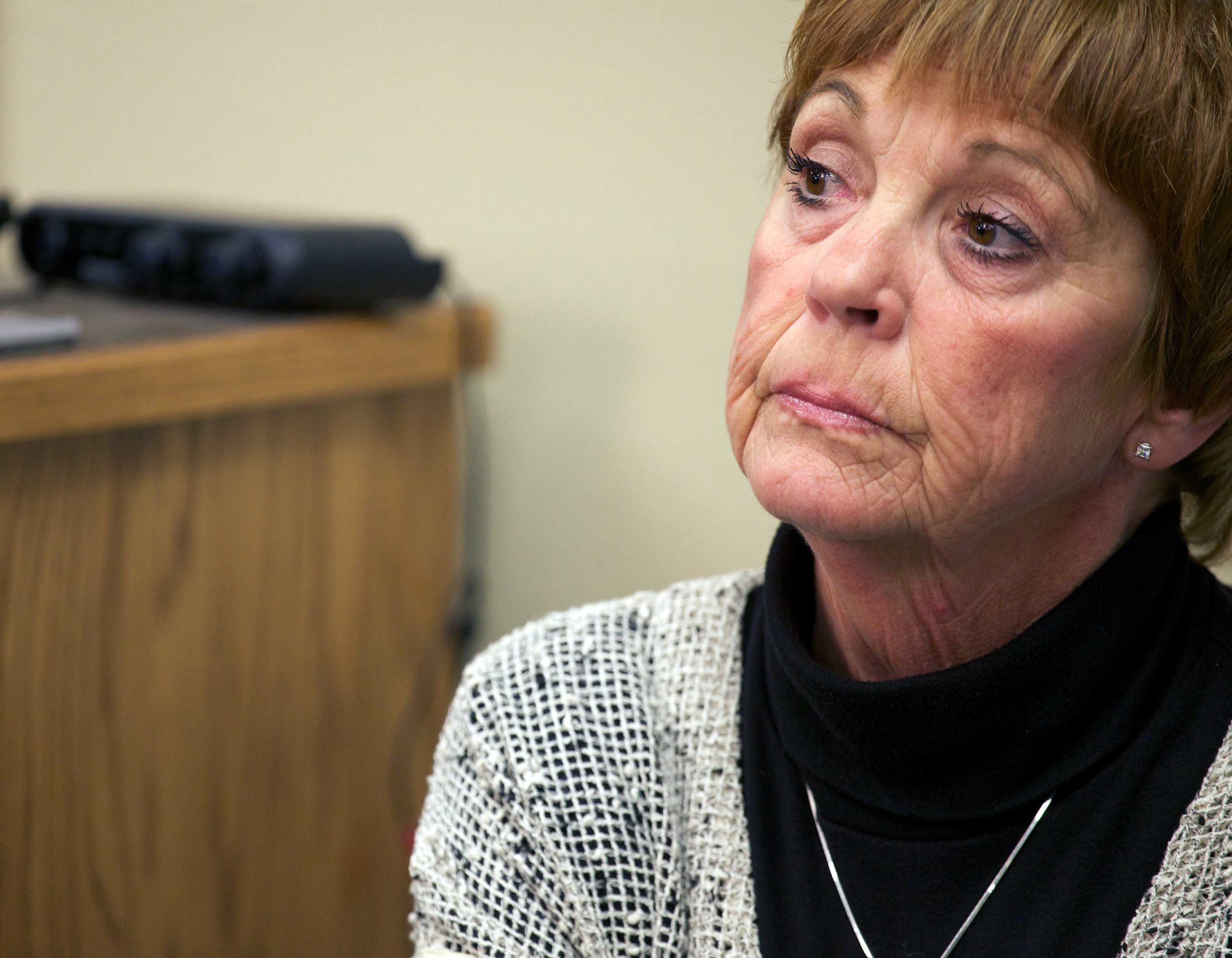 """Lynette Johnson, the wife of slain prison guard Ronald """"R.J."""" Johnson, reacts as media witnesses describe to reporters the final moments of murderer Eric Robert, her husband's killer, on Monday, Oct. 15, 2012, in Sioux Falls, S.D. Robert and another inmate, Rodney Berget, killed Ron Johnson in April 2011 during a failed prison escape attempt. The Monday execution marked the first execution in five years and the second in more than half a century for the state. (AP Photo/Amber Hunt)"""