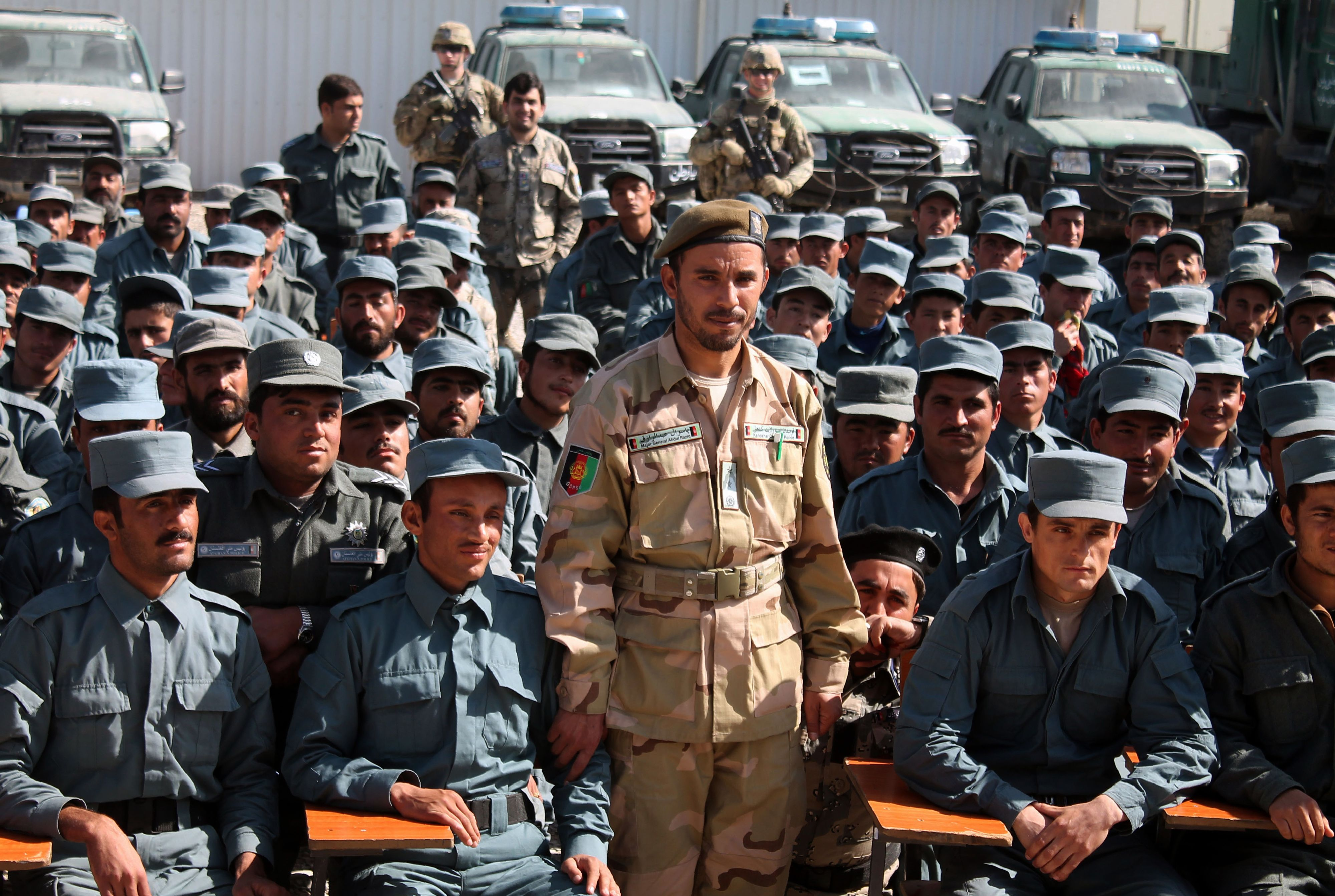 In this photo taken on February 19, 2017, Afghan General Abdul Raziq (C), police chief of Kandahar, poses for a picture during a graduation ceremony at a police training centre in Kandahar province. - An Afghan security chief and a journalist were killed and three Americans wounded on October 18 when a gunman opened fire on a high-level security meeting attended by top US commander General Scott Miller, officials said. (Photo by JAWED TANVEER / AFP) (Photo credit should read JAWED TANVEER/AFP/Getty Images)