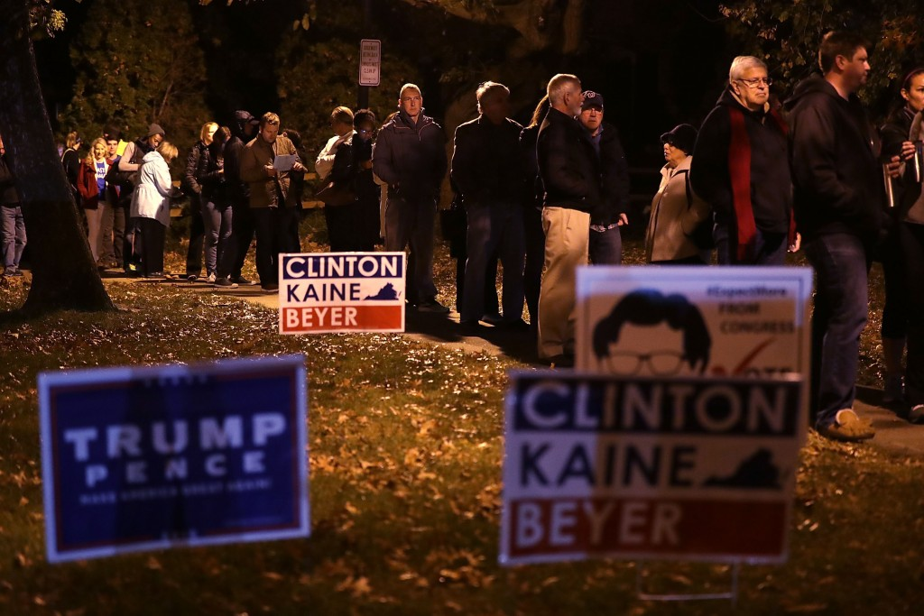 ALEXANDRIA, VA - NOVEMBER 08: Voters wait in-line for casting their ballots outside a polling place on Election Day November 8, 2016 in Alexandria, Virginia. Americans across the nation are picking their choice for the next president of the United States. (Photo by Alex Wong/Getty Images)