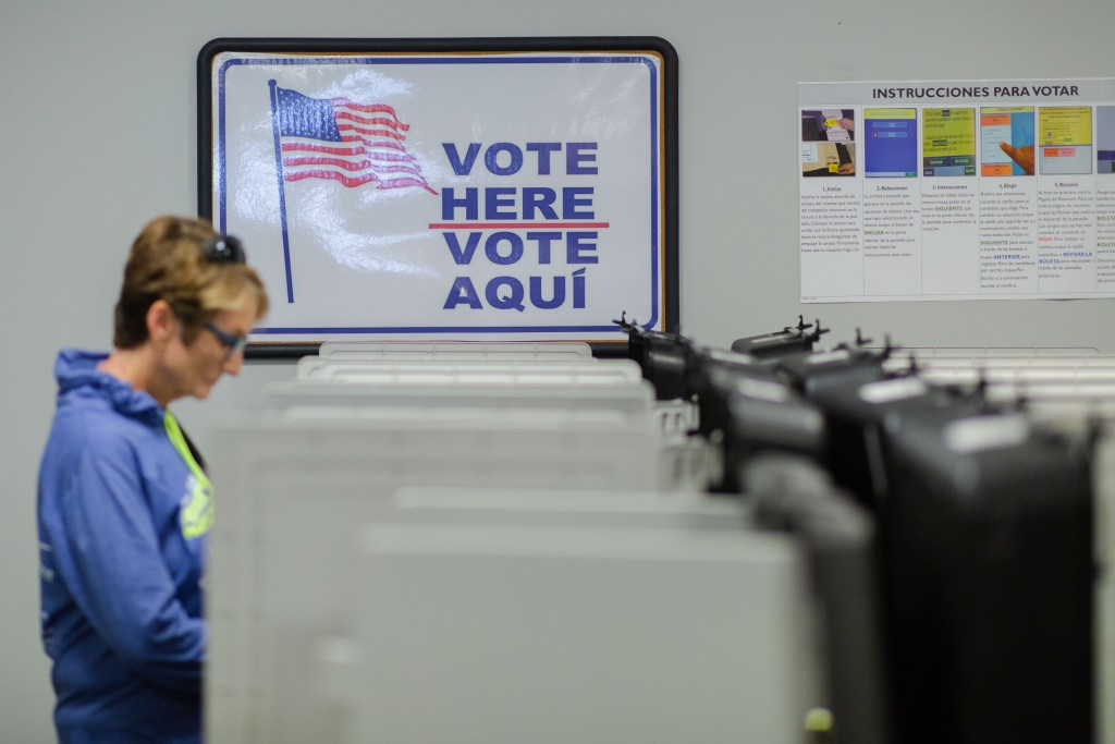 Signs in both English and Spanish hang on the walls as voters participate in early voting at the Gwinnett County (Ga.) Voter Registrations and Elections Office in Lawrenceville, Ga., on Wednesday, Oct. 17, 2018. Photo by Kevin D. Liles for The Intercept