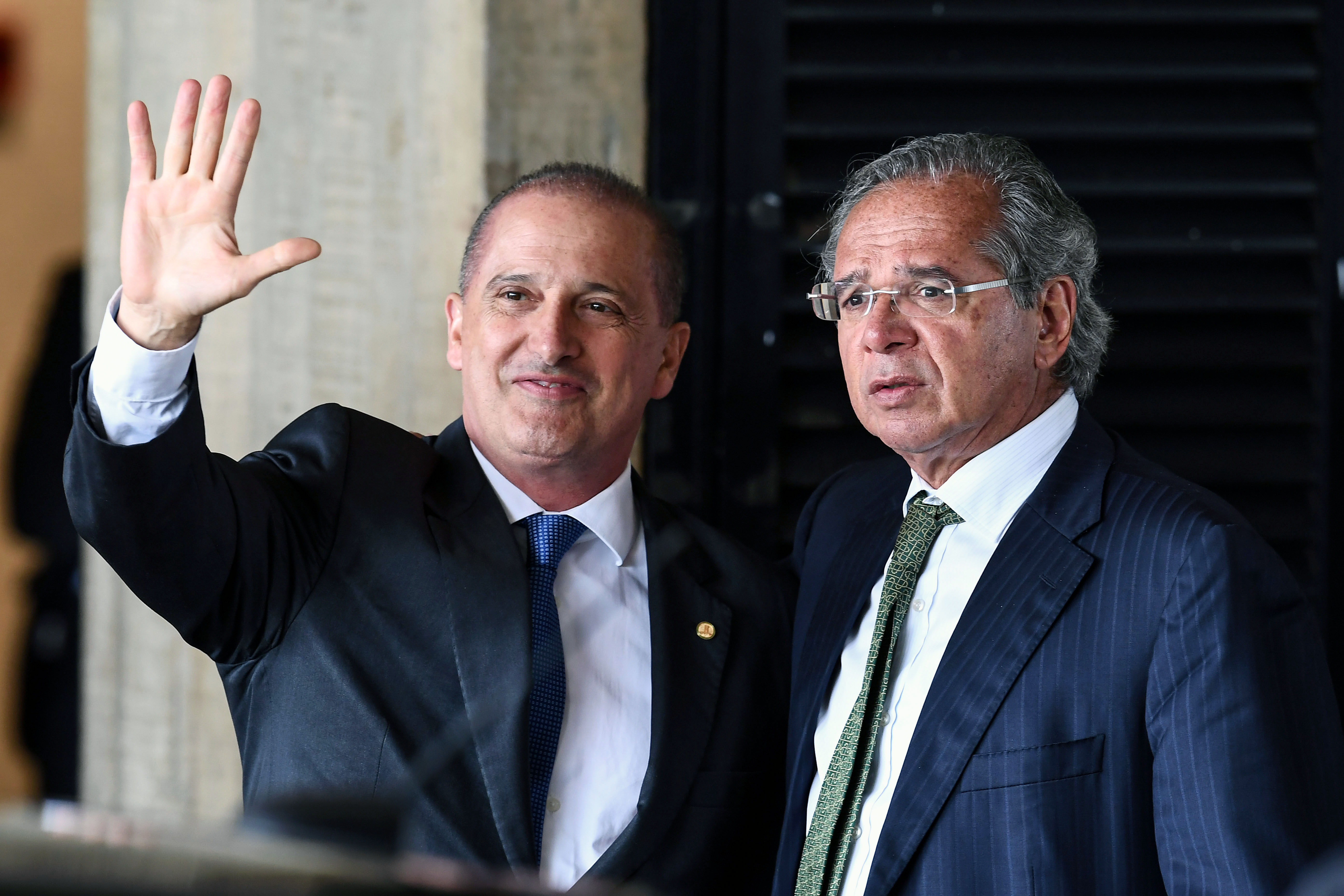 Onyx Lorenzoni (L), the future Chief of Staff of Brazilian president-elect Jair Bolsonaro's government and Paulo Guedes, who was appointed as Finance Minister gesture uppon arrival at the transitional government's headquarters in Brasilia on November 21, 2018. (Photo by EVARISTO SA / AFP)        (Photo credit should read EVARISTO SA/AFP/Getty Images)