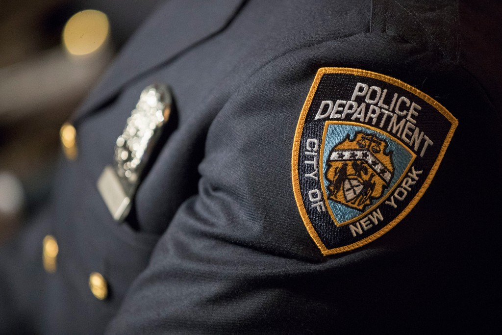 A detail including the badge and shield of one of the newest members of the New York City police is seen during his graduation ceremony, Thursday, June 29, 2017, in New York. Over 400 men and women took the oath of office and pledged to protect the people of New York City in a in a ceremony held at the Madison Square Garden Theatre. (AP Photo/Mary Altaffer)