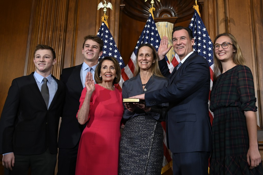 House Speaker Nancy Pelosi of Calif., third from left, poses during a ceremonial swearing-in with Rep. Tom Suozzi, D-N.Y., second from right, on Capitol Hill in Washington, Thursday, Jan. 3, 2019, during the opening session of the 116th Congress. (AP Photo/Susan Walsh)