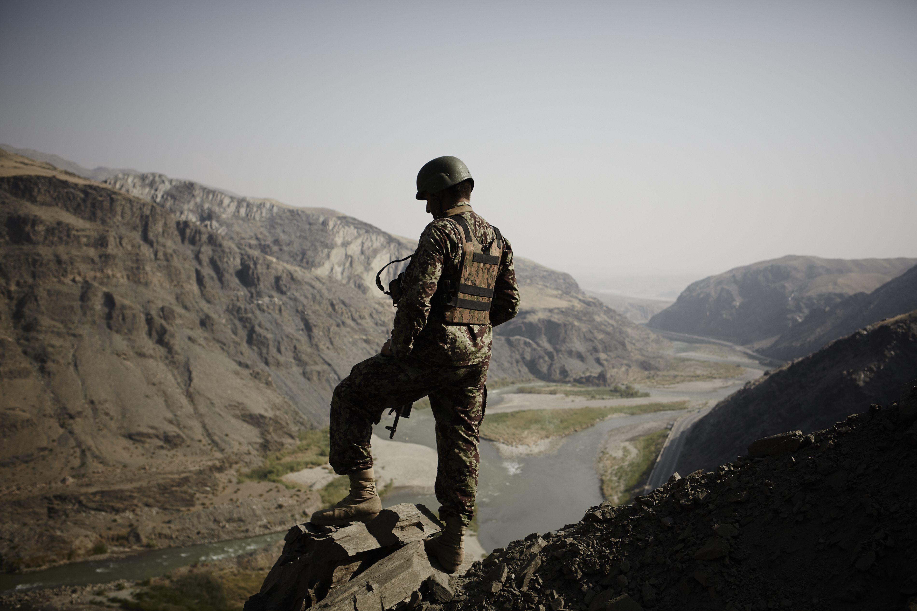 ***Award winning Sipa photographer Sebastiano Tomada spent several weeks inside the Afghan National Army - traveling to the combat outpost in the Laghman Province, living with the troops and witnessing the start of the fighting season 2013***A Afghan National Army soldier overlooks a valley in eastern Afghanistan.Afghanistan has seen a very active start to its fighting season in 2013.The Afghan National Security Forces in particular the ANA(AfghanNationalArmy) has been at the fore front of the fight, while the NATO led International Security Assistance Force has largely disengaged and transitioned into a supporting,advising and training role while preparing for its exit from the country. (Photo by Sebastiano Tomada/Sipa USA)
