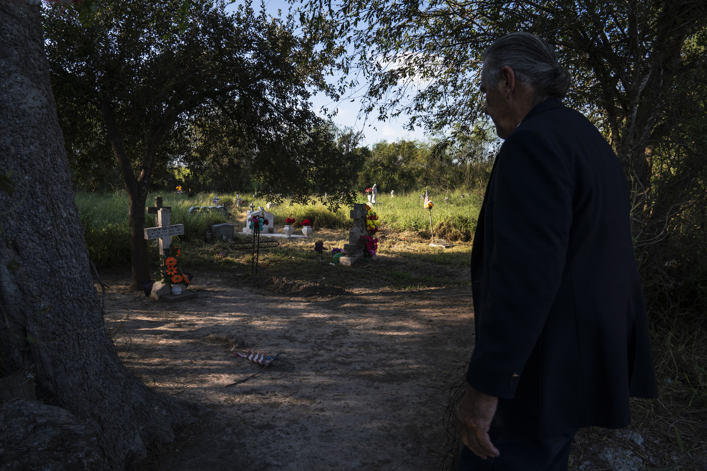 Ramiro Roberto Ramírez's walks into Eli Jackson Cemetery where his ancestors are buried in San Juan, Tex. on Nov. 6, 2018. The new proposed wall would leave this property on the south side of it. Photo: Verónica G. Cárdenas for The Intercept