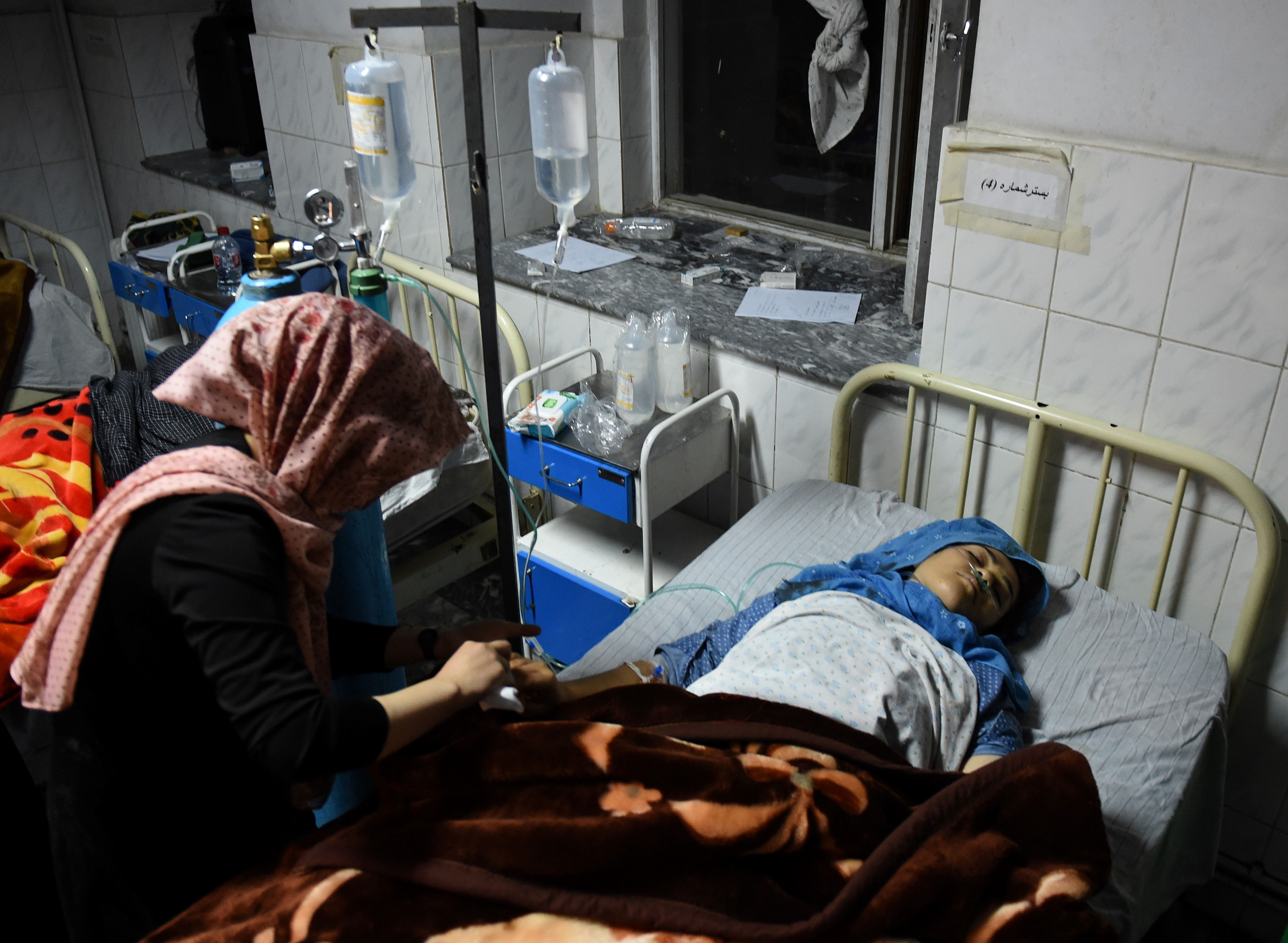 TOPSHOT - An Afghan wounded girl receives treatment at the Ali Abad hospital after an attack by gunmen inside the Kart-e- Sakhi shrine in Kabul on October 11, 2016. Gunmen targeted Shiite pilgrims in Kabul late Tuesday, killing at least 14 people as they gathered to celebrate Ashura, one of the most important festivals on the Shiite calendar, officials said.The attack in the Afghan capital marked unravelling security as the resurgent Taliban continued to pressure Afghan forces, with hundreds of commandos sent to reinforce the provincial capital Lashkar Gah in the south.Some 36 people were wounded and at least one attacker killed in the Kabul attack, interior ministry spokesman Sediq Sediqqi said. / AFP / WAKIL KOHSAR (Photo credit should read WAKIL KOHSAR/AFP/Getty Images)