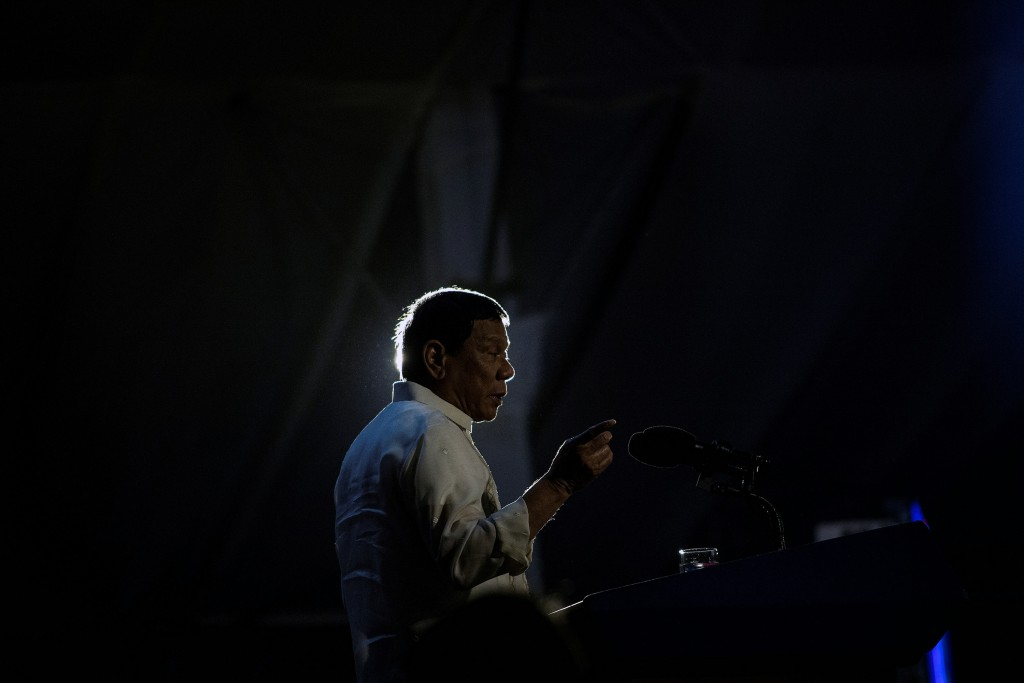 """Philippine President Rodrigo Duterte delivers a speech during the """"Digong's Day for Women"""" event on March 31, 2017.  Philippine President Rodrigo Duterte on March 30 described two major media outlets as """"sons of whores"""" and warned them of karmic repercussions for their critical coverage of his deadly drug war. / AFP PHOTO / NOEL CELIS        (Photo credit should read NOEL CELIS/AFP/Getty Images)"""