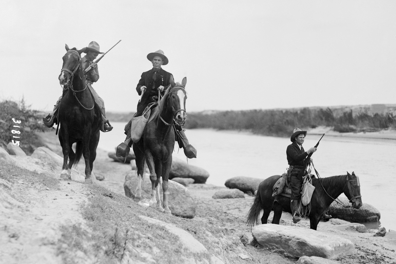 (Original Caption) Texas Rangers patrolling the border.
