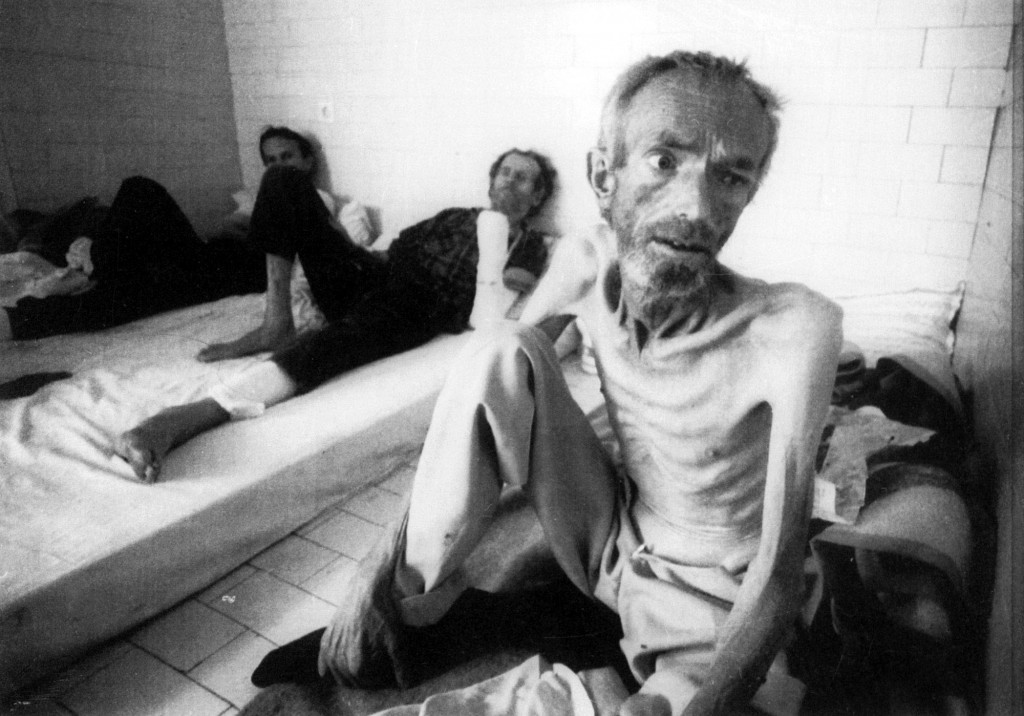 FILE--A Muslim prisoner sits in a sleeping room in the Trnopolje detention camp, near Banjaluka, some 12 miles northwest of Sarajevo, in this Aug. 12, 1992, file photo. Fifty years after the Geneva Conventions outlined the laws of war in the aftermath of World War II, a group of combat correspondents and legal scholars has written a guide to the ways fighting men have broken those codes of conduct.  (AP Photo/Today London, David Cairns, File) UK OUT