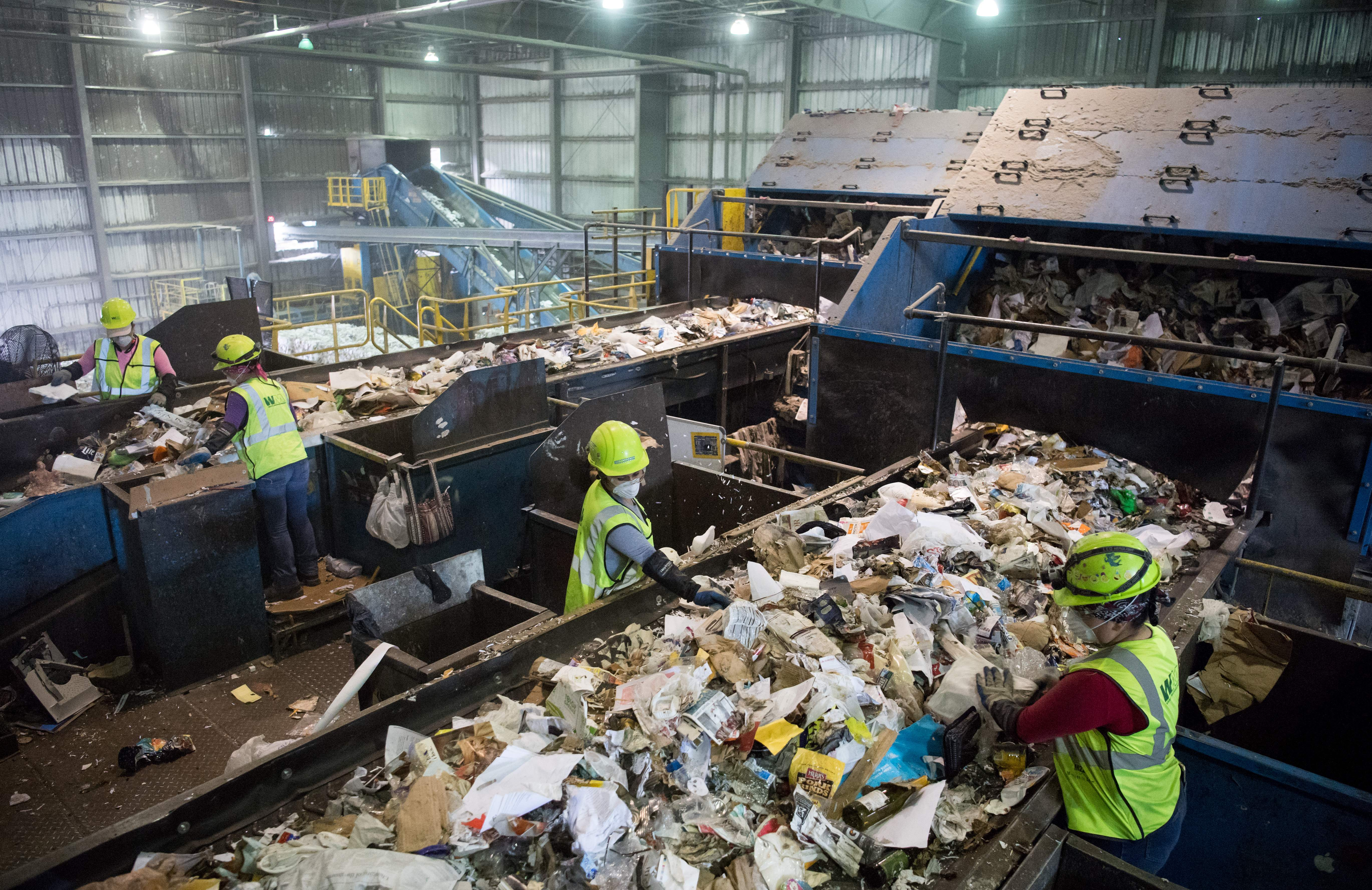 """it has to pay to get rid of huge amounts of paper and plastic it would normally sell to China. But Beijing is no longer buying, claiming the recycled materials are """"contaminated."""""""