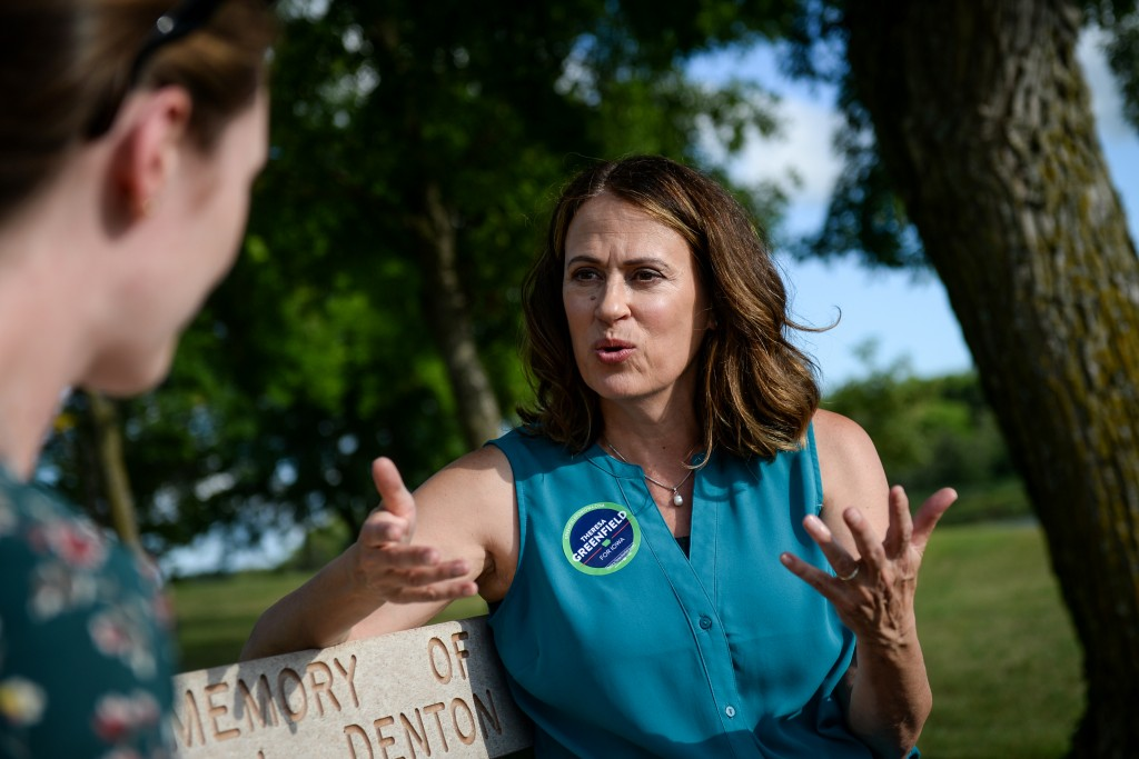 UNITED STATES -  AUGUST 11: Democratic senate candidate Theresa Greenfield speaks with a reporter at a picnic hosted by the Adair County Democrats in Greenfield, Iowa on Sunday August 11, 2019. (Photo by Caroline Brehman/CQ Roll Call)