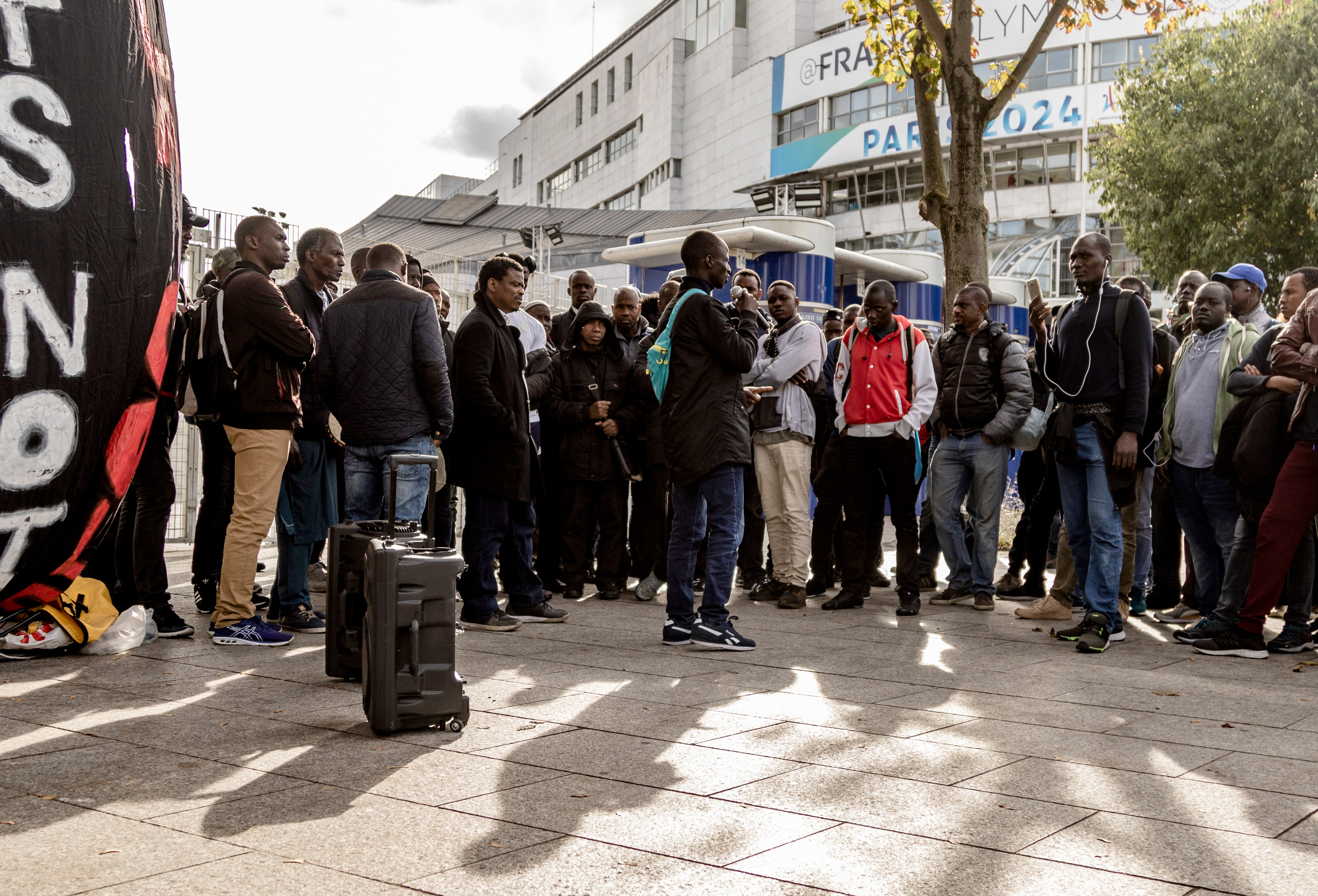 The rally of Gilet Noirs outside Charlety Stadium, Friday, Oct. 11, 2019. (Emma Francis/The Intercept)