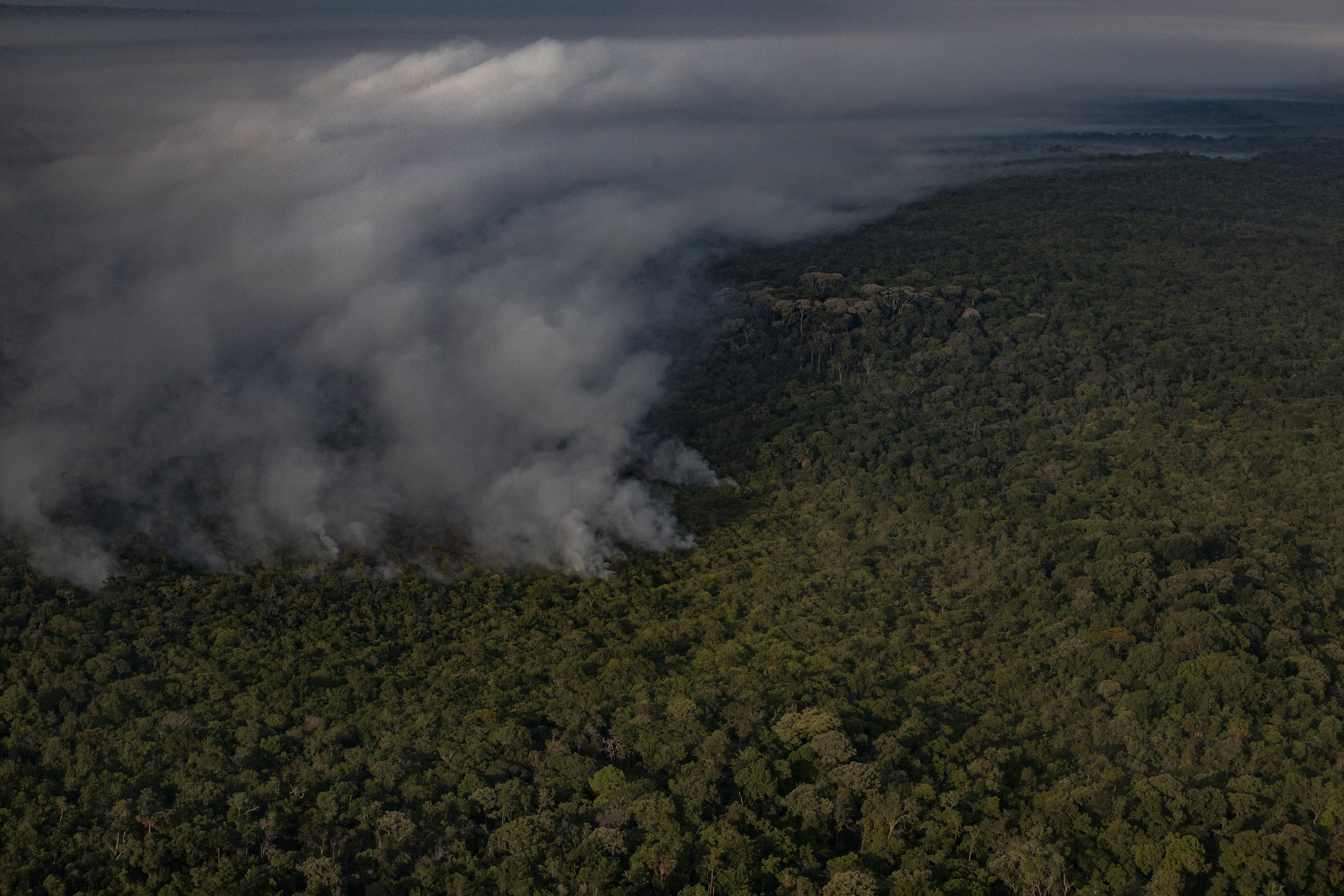 An aerial view of a burned forest area next to a cattle ranch in the state of Pará in Altamira, Brazil, Aug. 31, 2019. A deal reached 10 years ago was meant to stop the setting of fires by ranchers and others, but the ecological arson continues as the Earth warms. (Victor Moriyama/The New York Times) (GDA via AP Images)