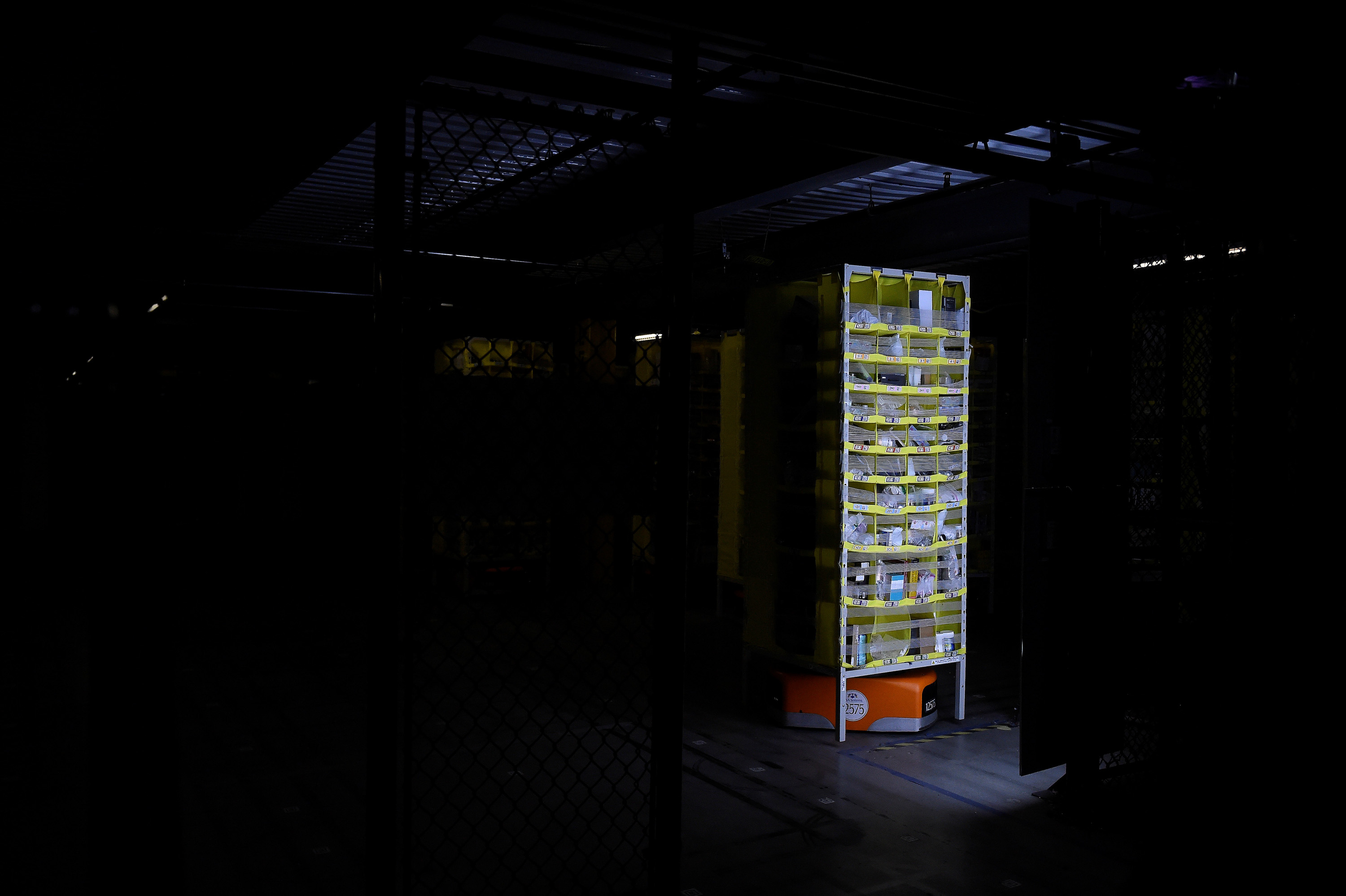 Amazon robotic shelves move to various sorting stations at the Amazon fulfillment center in Baltimore, Maryland, U.S., April 30, 2019. REUTERS/Clodagh Kilcoyne - RC1872CB8460