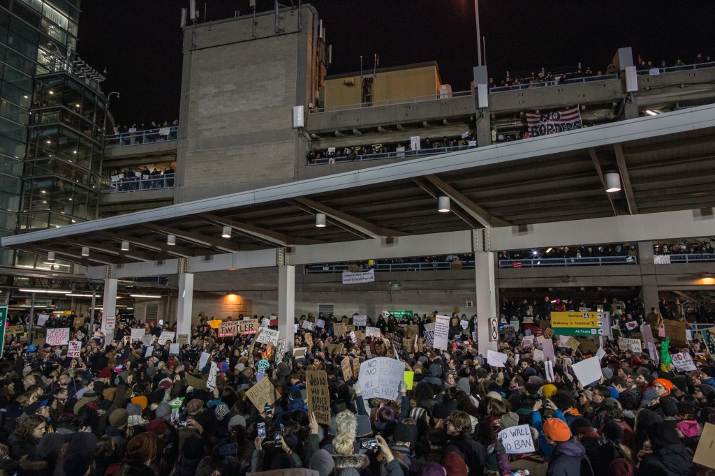 Protestors rally during a demonstration against the Muslim immigration ban at John F. Kennedy International Airport on January 28, 2017 in New York City. President Trump signed an executive order to suspend refugee arrivals and people with valid visa from Iran, Iraq, Libya, Somalia, Sudan, Syria and Yemen. (Photo by Maite H. Mateo/Corbis via Getty Images)