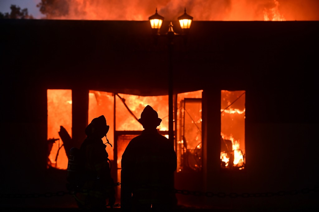 ST. PAUL, MINNESOTA -- Firefighters watch as flames devour a building on University Ave. and Syndicate St. in St. Paul's Midway neighborhood Thursday, May 28, 2020, following the Monday death of George Floyd while in police custody in Minneapolis. (John Autey / MediaNews Group / St. Paul Pioneer Press via Getty Images)