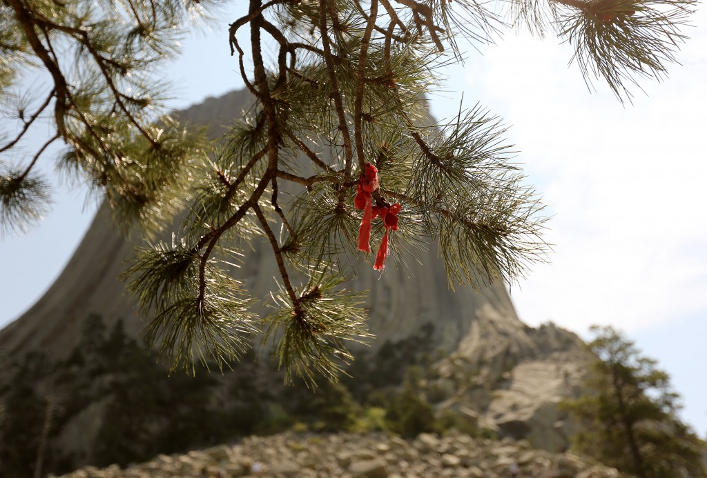 Native American prayer ties are shown along the walking trail at Devils Tower National Monument in Devils Tower, Wyo. on July 9, 2015.