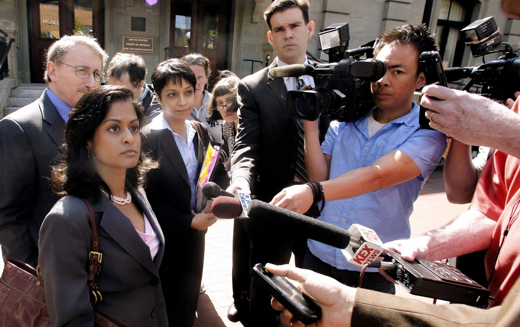 """FILE - This May 11, 2012, file photo shows Nusrat Chadoury, lead attorney for the plaintiffs, National ACLU National Security Program, talking with reporters following oral arguments on the ACLU No Fly List challenge, in Portland, Ore.  A federal appeals court ruled Thursday that a lawsuit over the government's no-fly list can go forward in a lower court in Oregon.""""More than two years ago, our clients were placed on a secret government blacklist that denied their right to travel without an explanation or chance to confront the evidence against them,"""" Nusrat Choudhury, an ACLU lawyer who argued the case, said in a statement. """"The Constitution requires the government to provide our clients a fair chance to clear their names and a court will finally hear their claims."""" (AP Photo/Rick Bowmer, File)"""