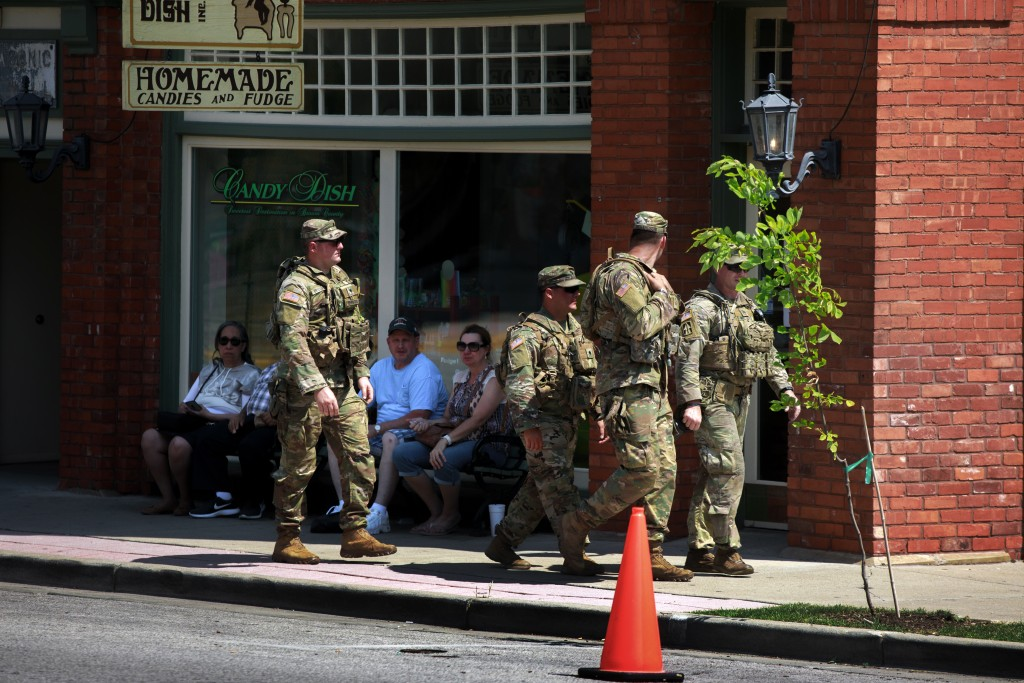 NASHVILLE, INDIANA, UNITED STATES - 2020/06/20: Members of the Indiana National Guard patrol the streets during the demonstration.<br /> Protest in solidarity with Black Lives Matter for Racial Justice in downtown Nashville. (Photo by Jeremy Hogan/SOPA Images/LightRocket via Getty Images)