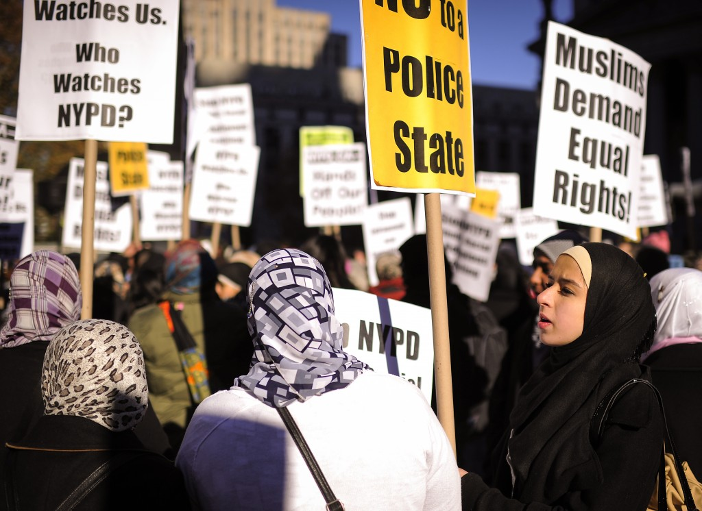 Members of the Muslim community stage a rally prior to performing Friday prayers on Foley Square in support of Occupy Wall Street against police brutality and surveillance in New York, November 18, 2011. AFP PHOTO/Emmanuel Dunand (Photo credit should read EMMANUEL DUNAND/AFP via Getty Images)