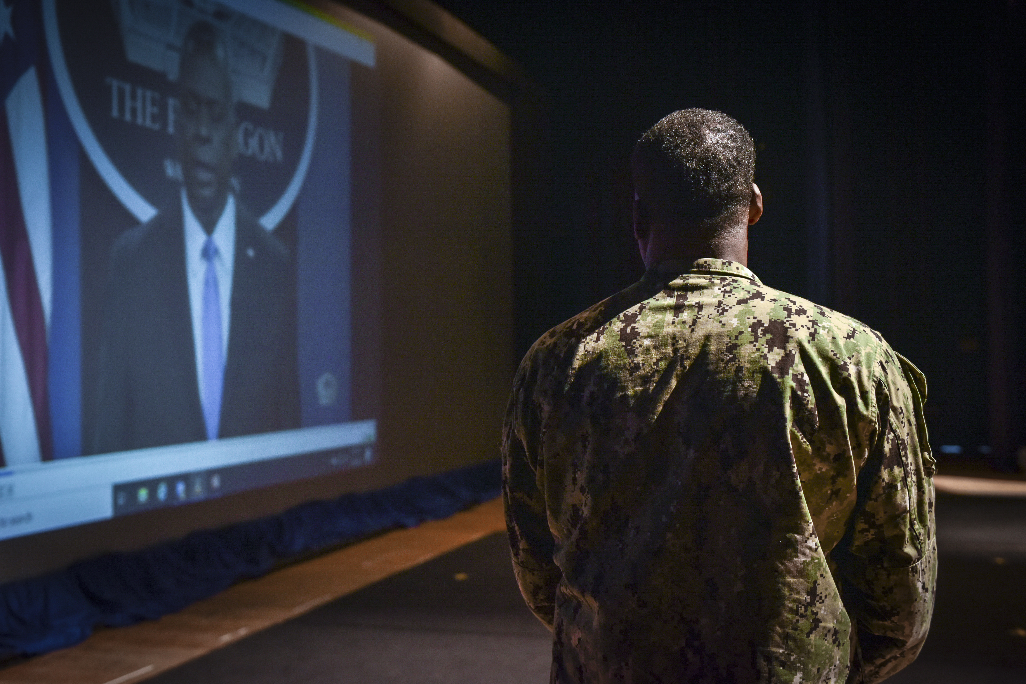 VIRGINIA BEACH, Va. (March 1, 2021) Capt. Michael Witherspoon watches a video of Secretary of Defense Lloyd Austin address extremism within the U.S. military during a mandated stand-down, March 1. The SECDEF directed commanding officers and supervisors at all levels to conduct a stand-down with their personnel to address extremism by April 6, 2021. (U.S. Navy photo by Travis J. Kuykendall/Released)