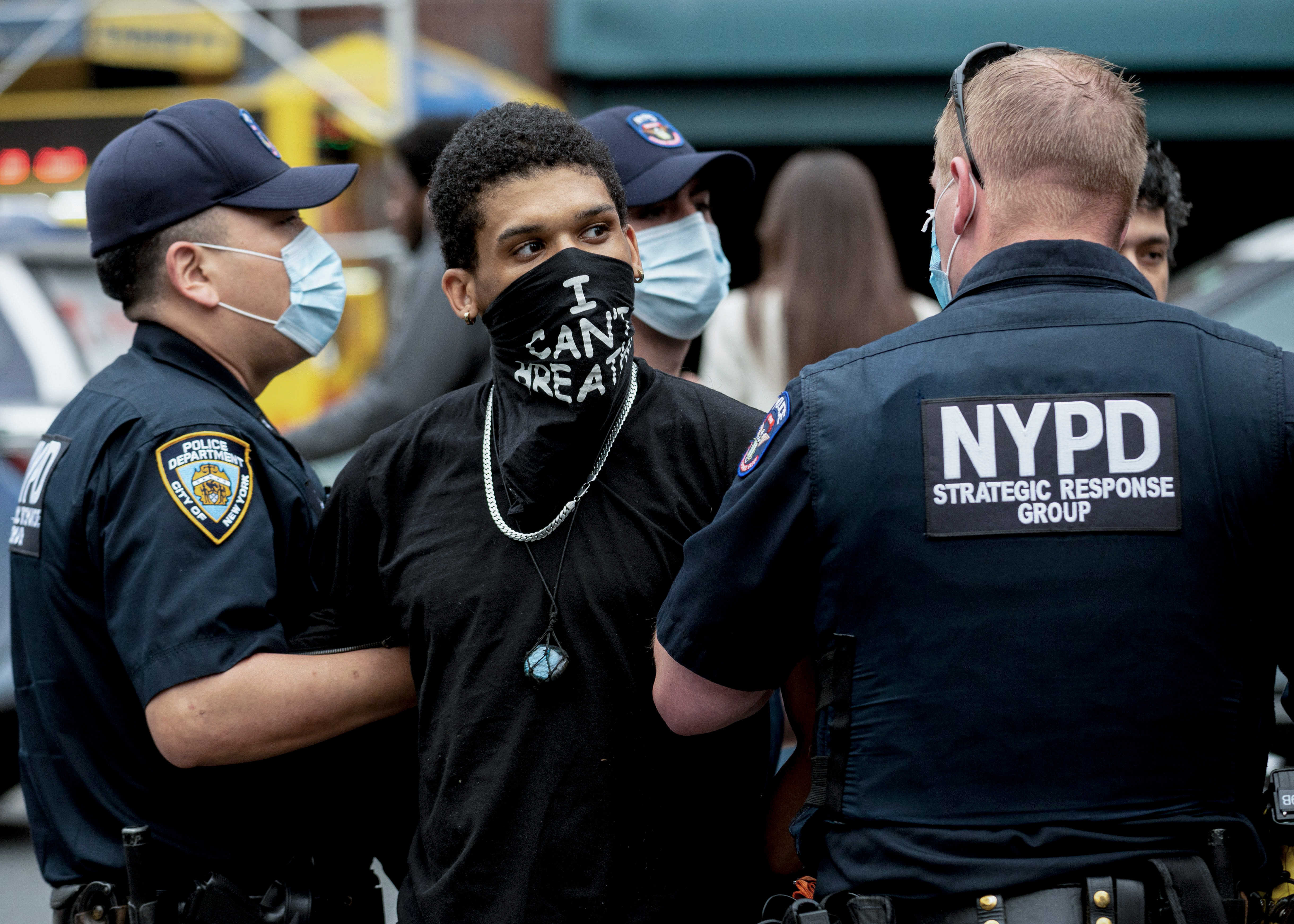 """NYPD officers arrest a protestor during a """"Black Lives Matter"""" demonstration on May 28, 2020 in New York City, in outrage over the death of a black man in Minnesota who died after a white policeman kneeled on his neck for several minutes. - Concern and anger over George Floyd's death spread around the country. House Democratic leader Nancy Pelosi said the video footage showed there was no excuse for his death.""""We saw a murder take place before our very eyes. And so the fact that the officers were fired, that's one thing, but there has to be some justice in all of this,"""" she said. (Photo by Johannes EISELE / AFP) (Photo by JOHANNES EISELE/AFP via Getty Images)"""