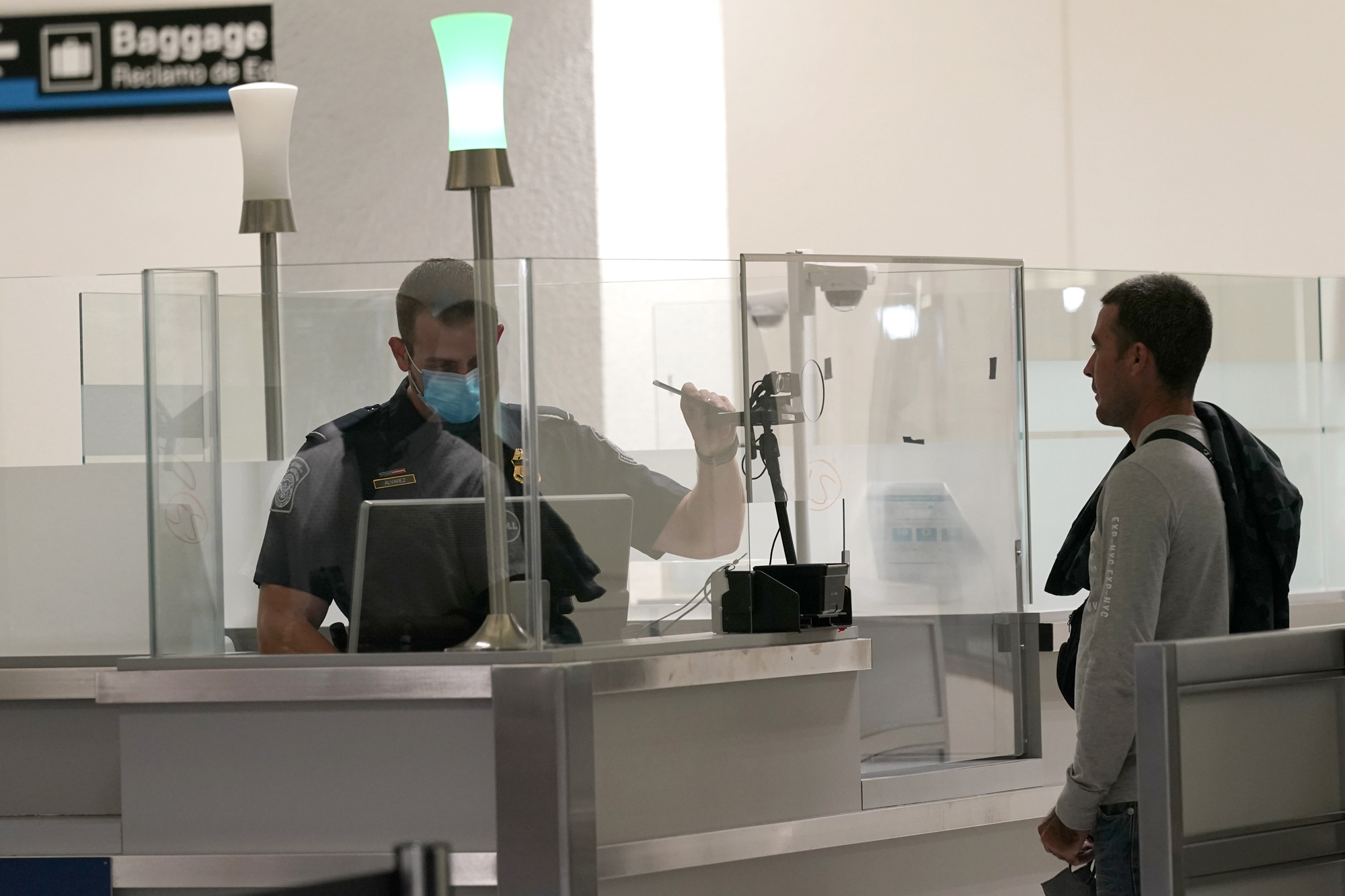 International passengers arrive at Miami international Airport where they are screened by U.S. Customs and Border Protection (CBP) using facial biometrics to automate manual document checks required for admission into the U.S. Friday, Nov. 20, 2020, in Miami. Miami International Airport is the latest airport to provide Simplified Arrival airport-wide. (AP Photo/Lynne Sladky)