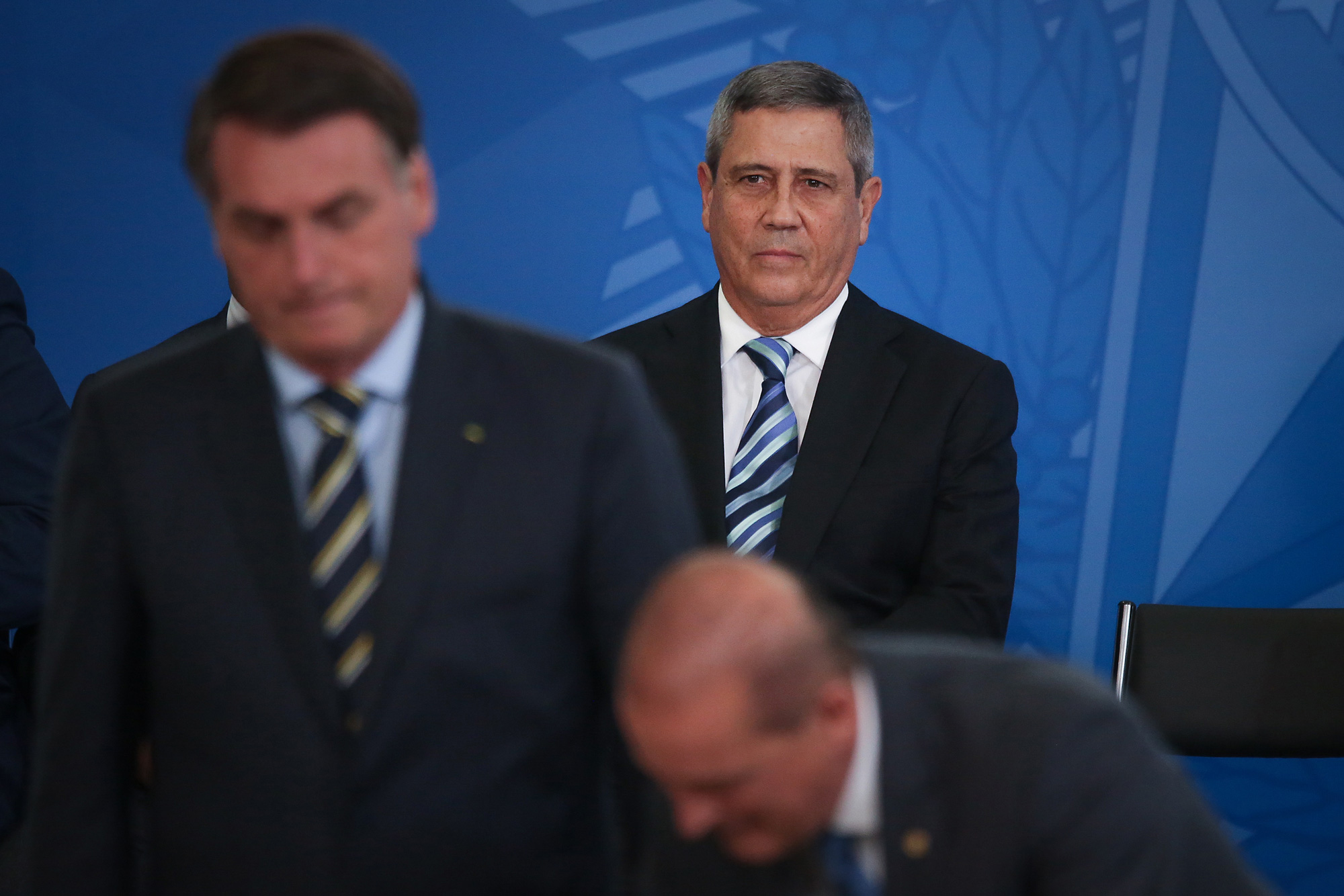 Walter Braga Netto, Brazil's incoming chief of staff, listens during a swearing-in ceremony at the Planalto Palace in Brasilia, Brazil, on Tuesday, Feb. 18, 2020. Brazil's slumping currency, the worst in the world year-to-date, was front and center of controversial remarks made by the nation's economy minister,Paulo Guedes.Photographer: Andre Coelho/Bloomberg via Getty Images