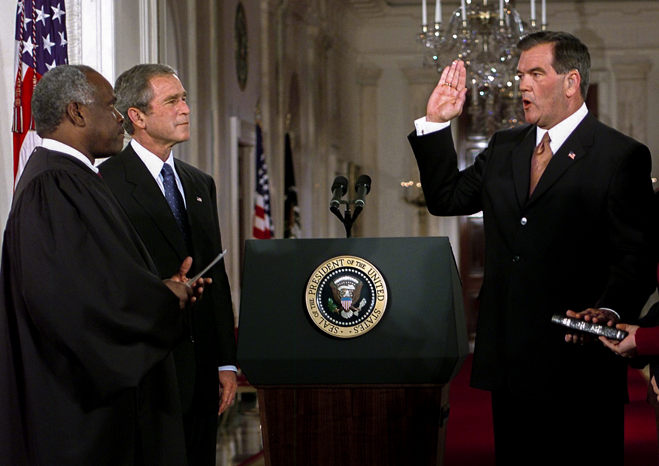 Former Pennsylvania governor Tom Ridge (R) is sworn-in as Director of the newly created Cabinet-level position of the Office of Homeland Security 08 October, 2001 by Supreme Court Justice Clarence Thomas (L) as US President George W. Bush watches in the East Room of the White House in Washington, DC. The new position was created by the president to deal with terrorism within US borders.   AFP Photo/Paul J. Richards (Photo credit should read PAUL J. RICHARDS/AFP via Getty Images)